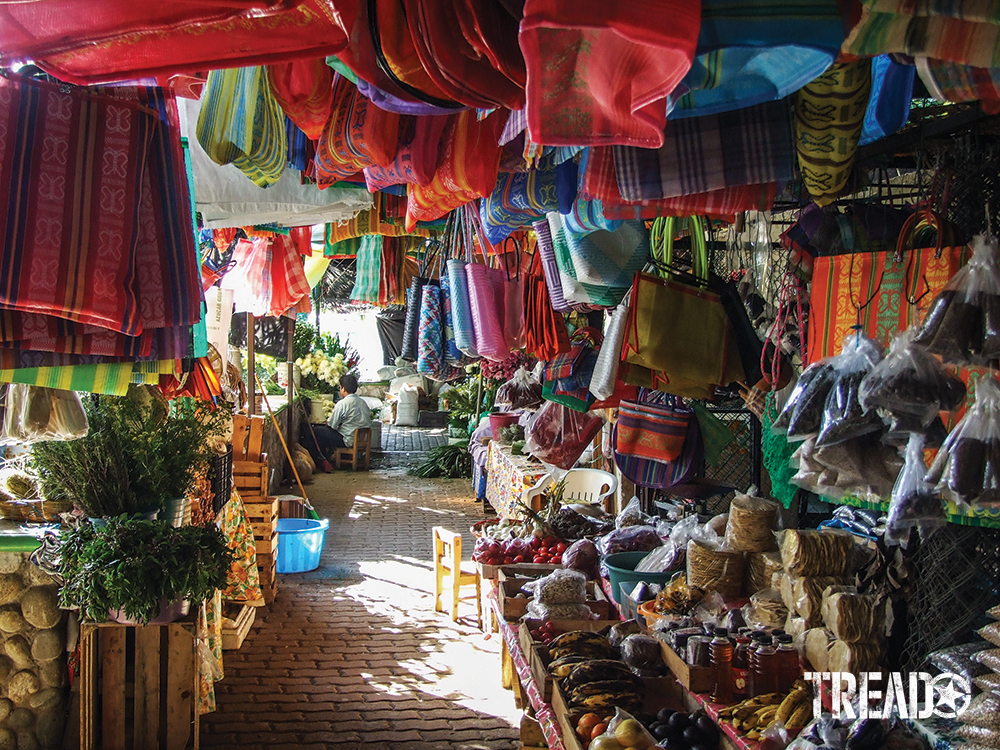 Bright colors goods and smiling faces complete the picture of a Baja marketplace.