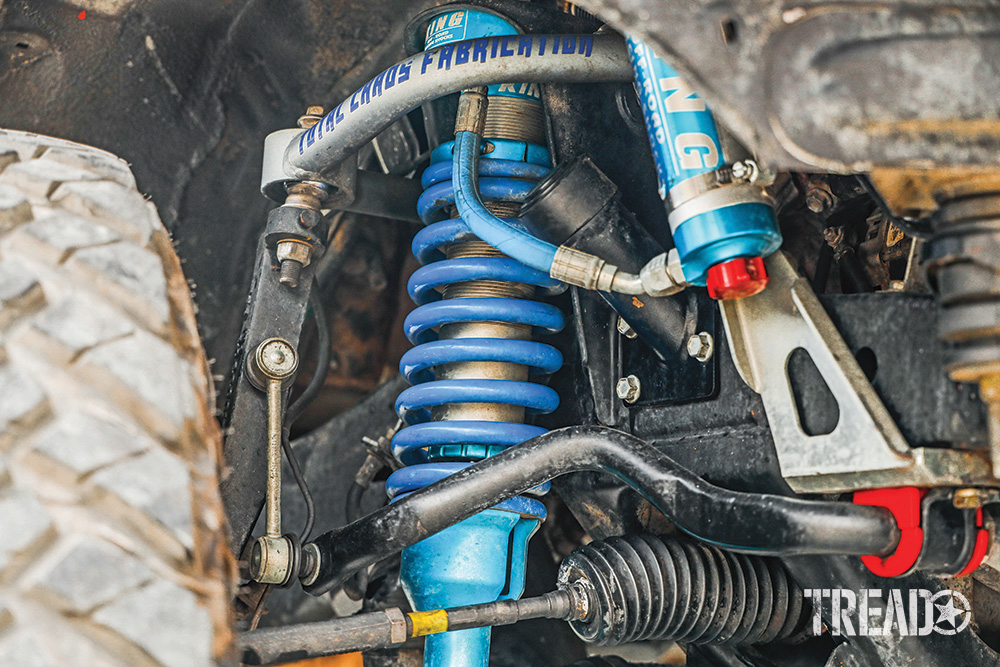 King Shocks 2.5 coilovers with reservoirs and Total Chaos UCAs are seen on an off-road Lexus GX 470.