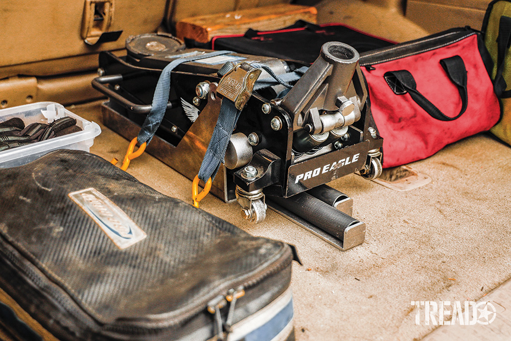 A Pro Eagle jack is securely mounted in the rear of the GX470, using blue straps.