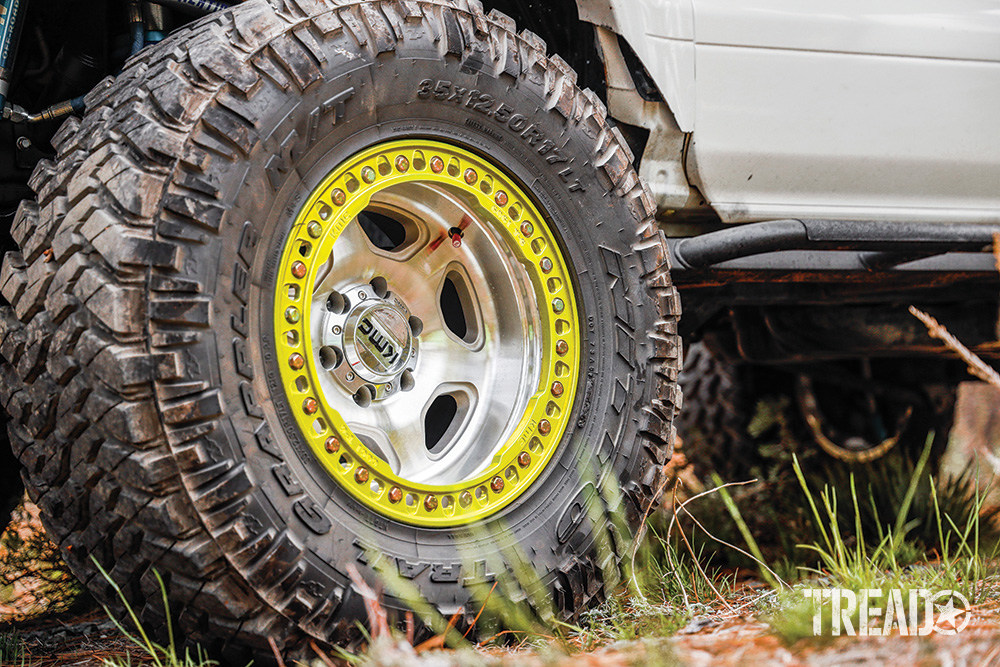 The off-road Lexus GX470 currently showcases silver wheels with a yellow ring around it's exterior, shod with beefy Nitto off-road tires.