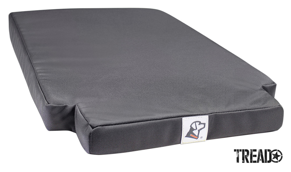 This nearly rectangular dark gray dog bed has a 1680 Denier-rated, ballistic nylon cover. It incorporates 2-inch cooling memory foam.