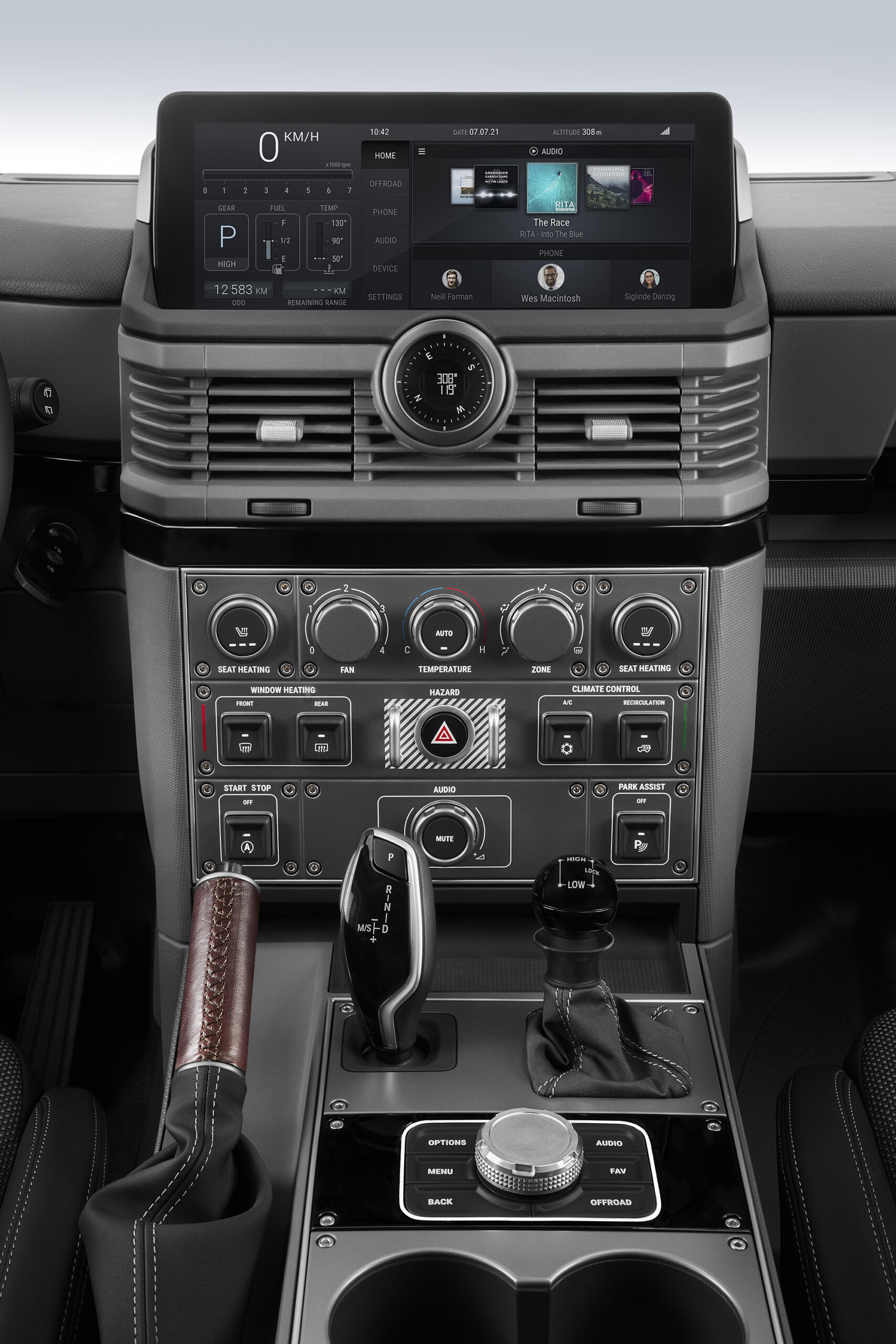 The center stack includes oversized toggle switches, rotary dials, and evenly spaced controls.