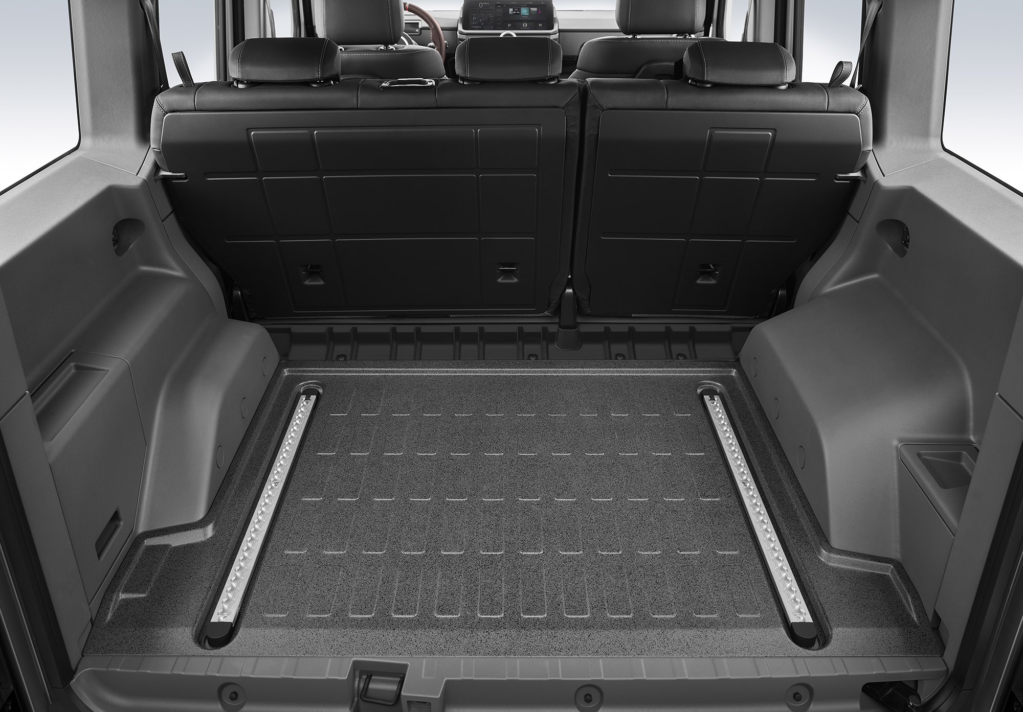 The black and gray rear cargo area includes secured storage areas and optional L-track railings to secure cargo.