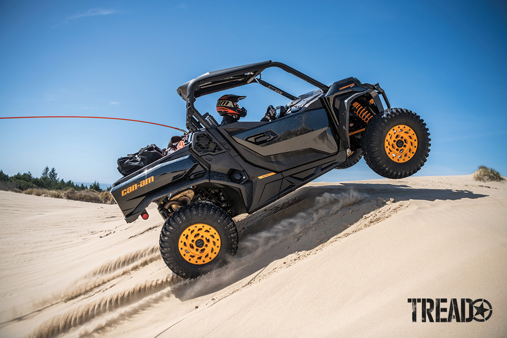 Can-Am Commander XT-P catches air on a sand dune.