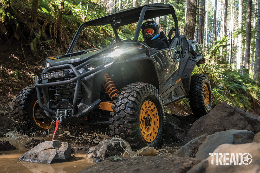 Can-Am Commander XT-P drives over water and rocks.