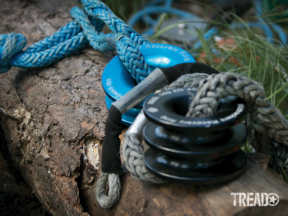 There are various-sized recovery rings on the market to help during the vehicle recovery process. From a blue single and double black rings lay on a log during a demonstration.