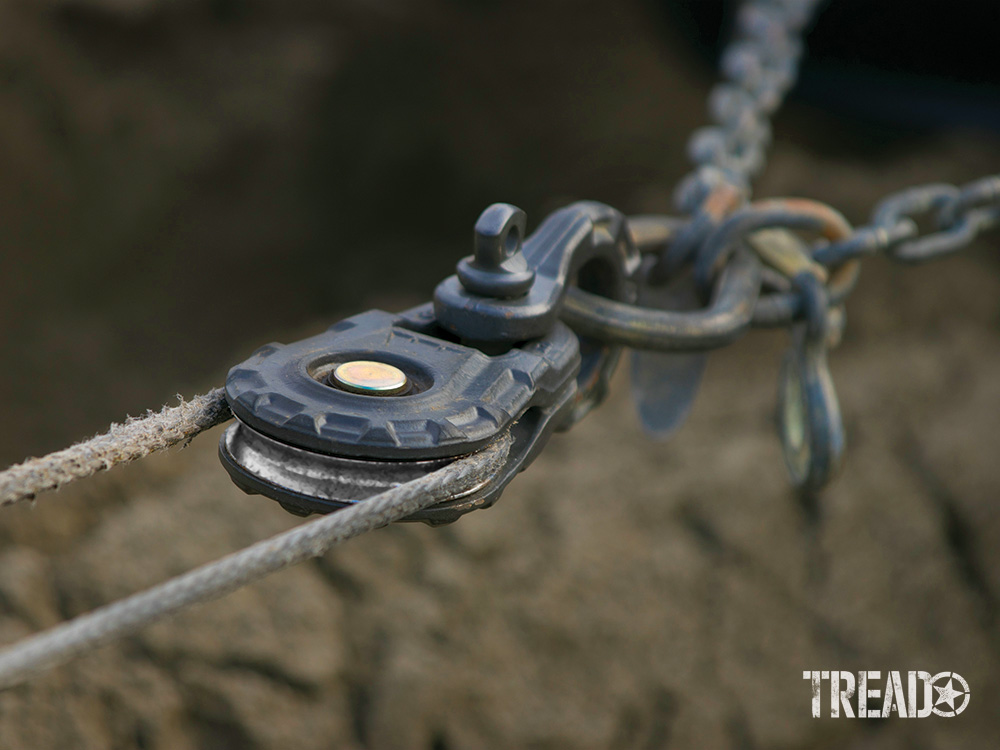 A WARN Epic snatch block and shackle is being used during a beach recovery.