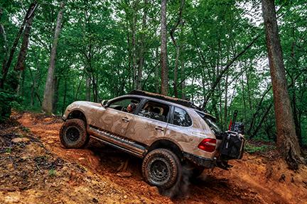 Porsche Cayenne drives in Uwharrie National Forest.