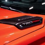 TRD Pro badging on 2022 Toyota Tundra TRD Pro in Solar Octane orange