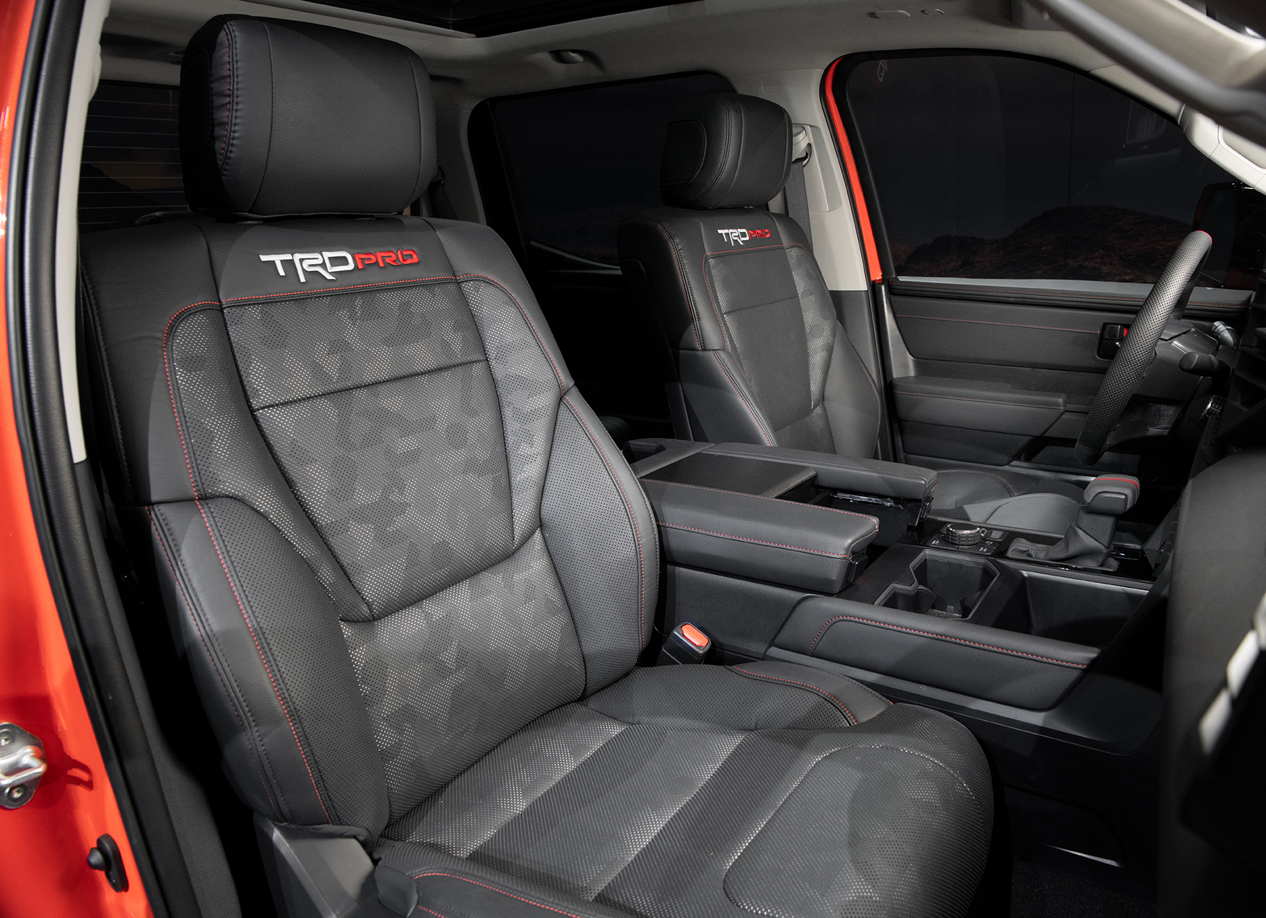 black interior seats of 2022 Toyota Tundra TRD Pro in Solar Octane orange