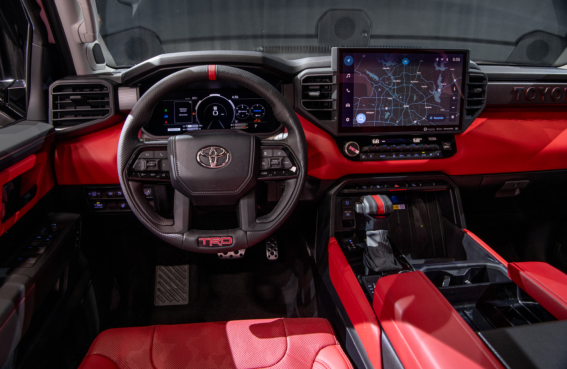 steering wheel of the all new red interior of 2022 Toyota Tundra TRD Pro in Super White