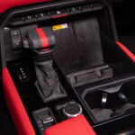 Gear shifter and red interior of red interior of 2022 Toyota Tundra TRD Pro in Super White