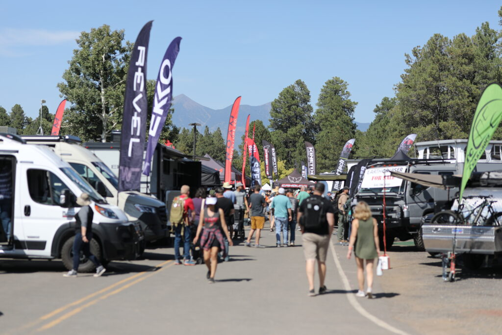 Crowd walking down aisle at Overland Expo West 2021